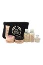 Vitamin E Collection Travel Exclusive by The Body Shop for Unisex - 7 Pc Kit 2oz Cream Cleanser, 2oz Hydrating Toner, 1.7oz Moisture Cream, 1.67oz Nourishing Night Cream, 0.5oz Eye Cream, Face Brush, Travel Bag